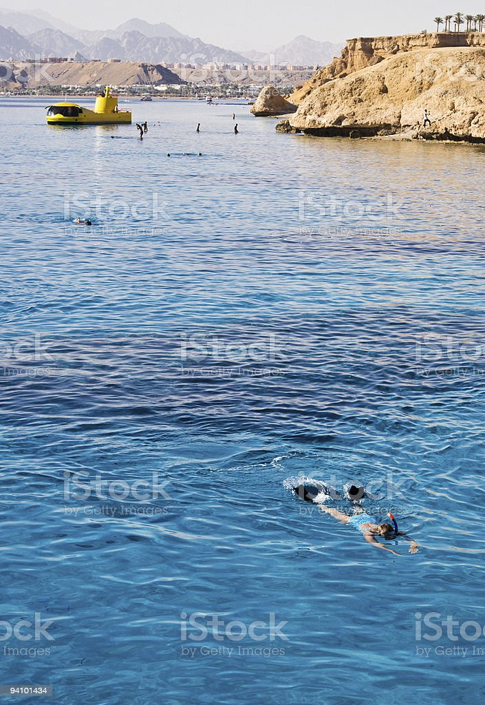 Woman Snorkeling in open blue lagoon stock photo