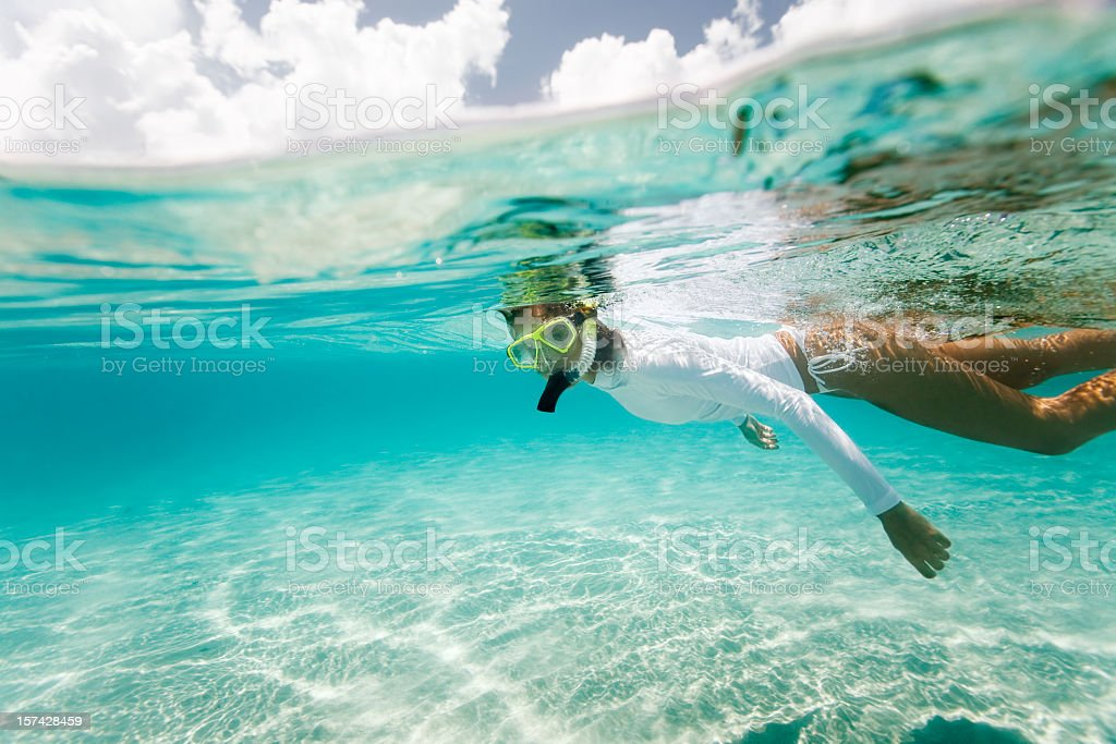 woman snorkeling in the Caribbean stock photo