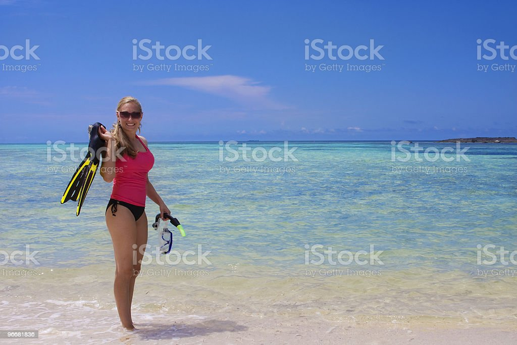 Woman Snorkeling in the Ocean stock photo