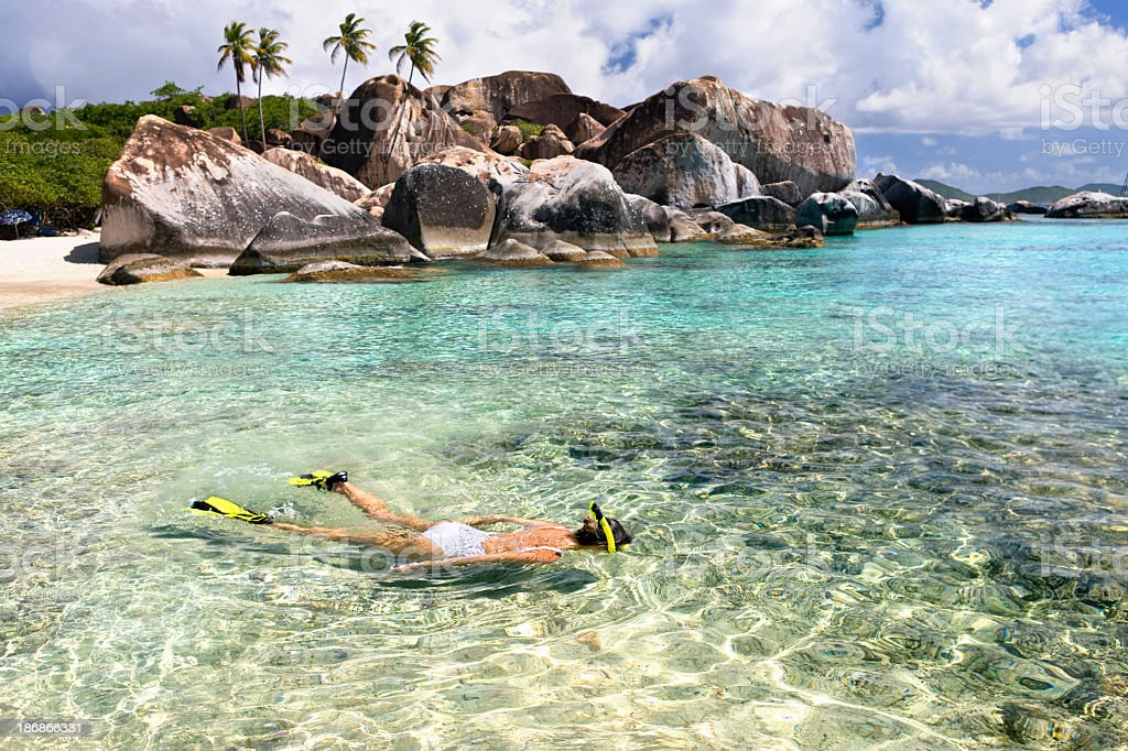 woman snorkeling in Virgin Gorda, BVI stock photo