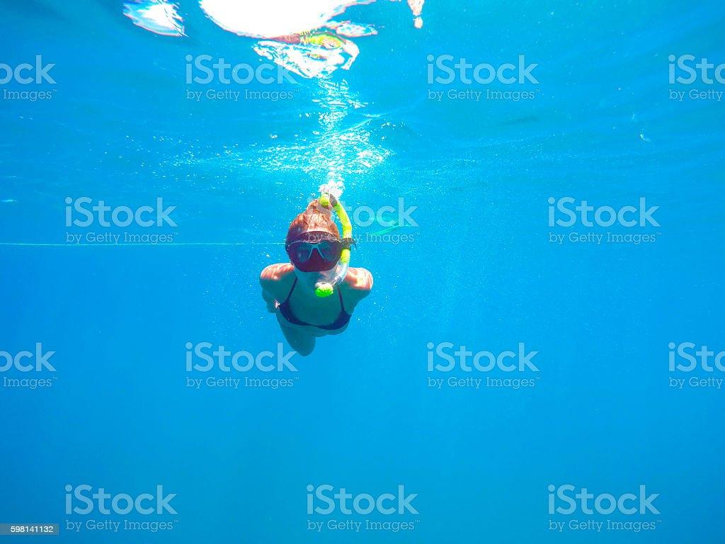 Woman snorkeling stock photo