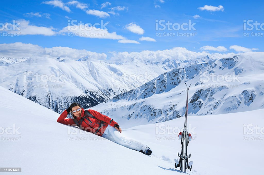 Woman snow skier on ski vacation royalty-free stock photo