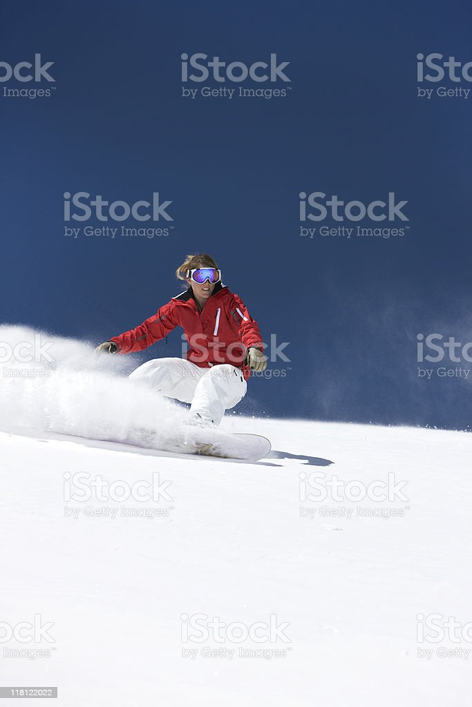 Woman Snowboarding Against Blue Sky royalty-free stock photo