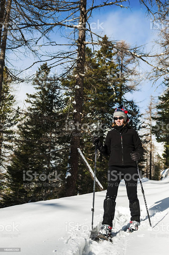 Woman Snowshoe Through Snowy Forest royalty-free stock photo