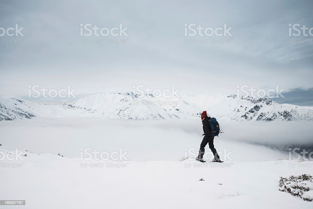 Woman Snowshoeing On Mountain Top royalty-free stock photo