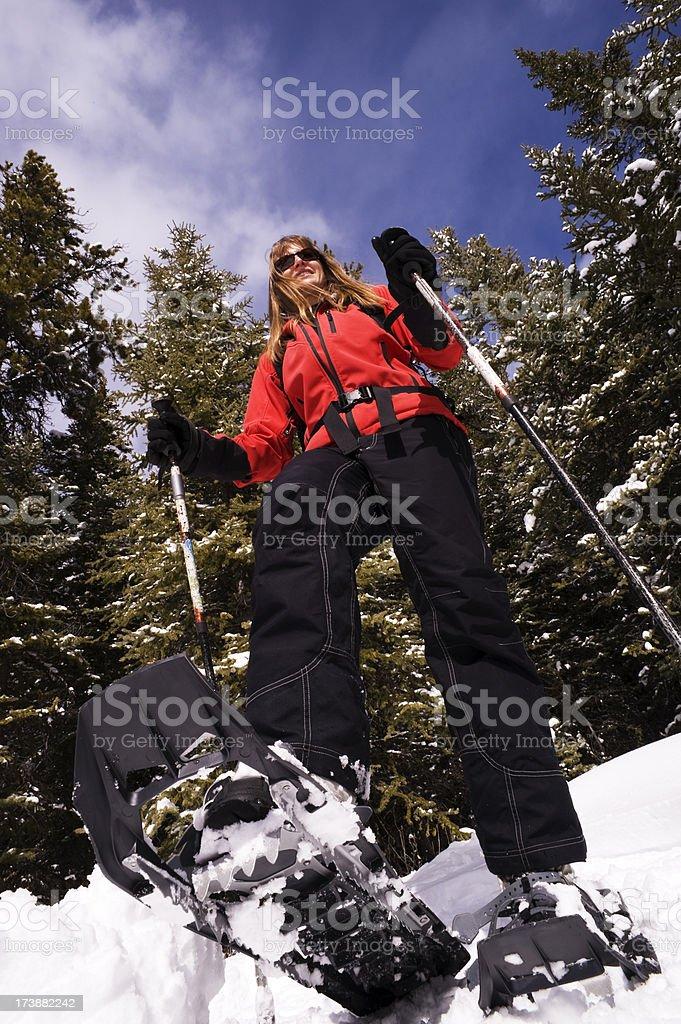 Woman Snowshoeing royalty-free stock photo