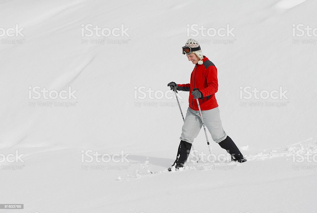 Woman Snowshoeing stock photo
