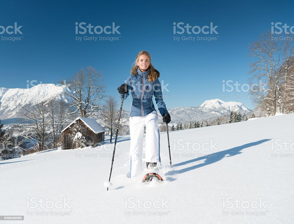 Woman Snowshoeing through a Winter Wonderland, Austrian Alps stock photo