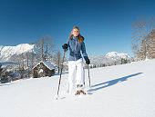 Woman Snowshoeing through a Winter Wonderland, Austrian Alps