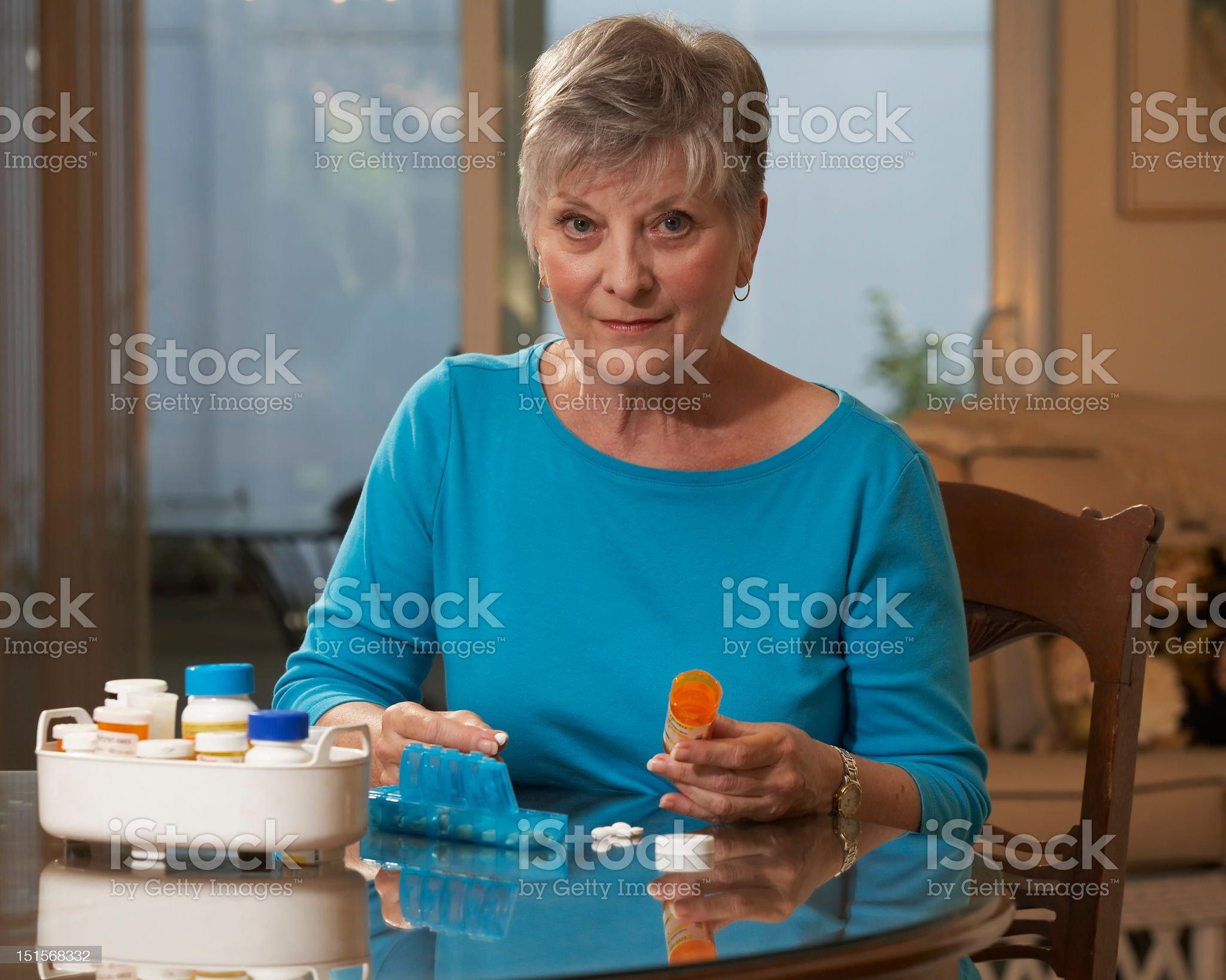 Woman sorting medications royalty-free stock photo