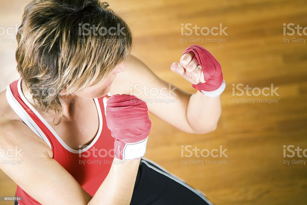 A woman sparring in martial arts class stock photo