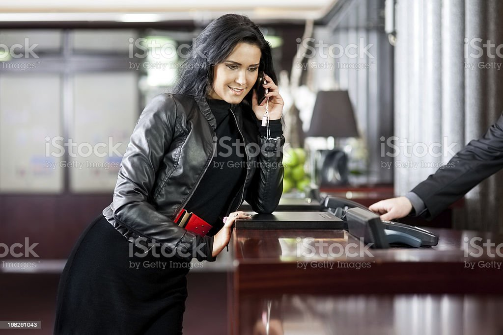 Woman speaking on the phone in a hotel royalty-free stock photo