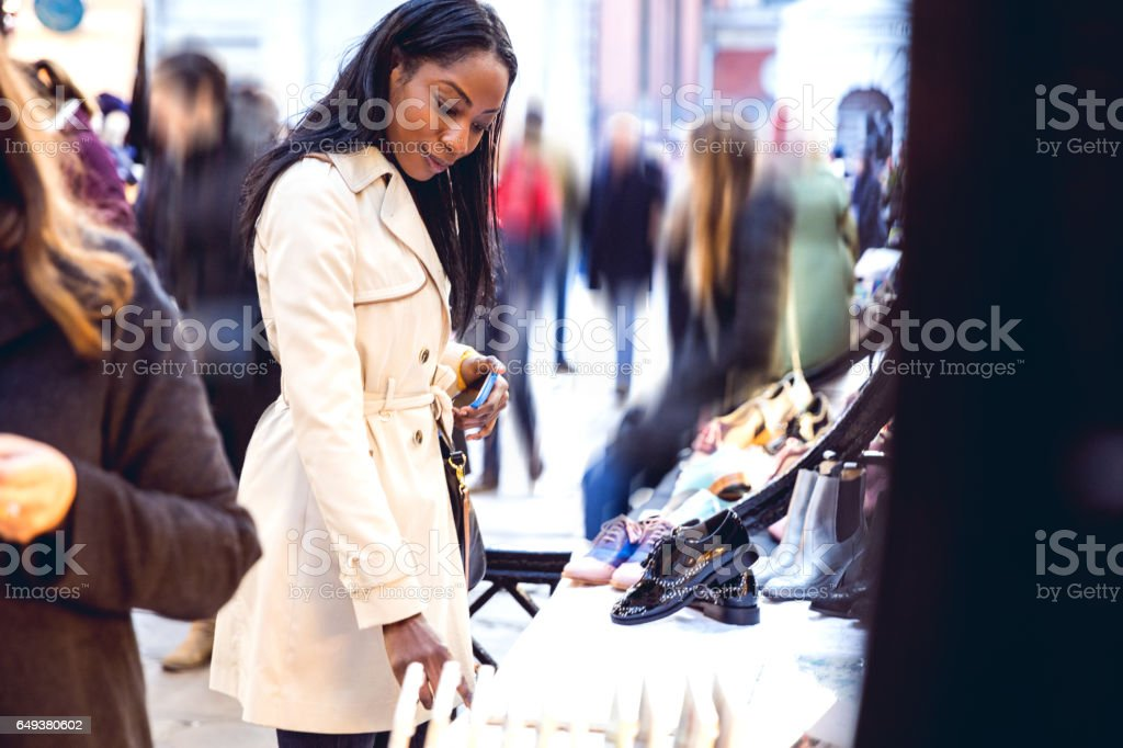 Woman spending a weekend in Central London buying at outdoor markets stock photo