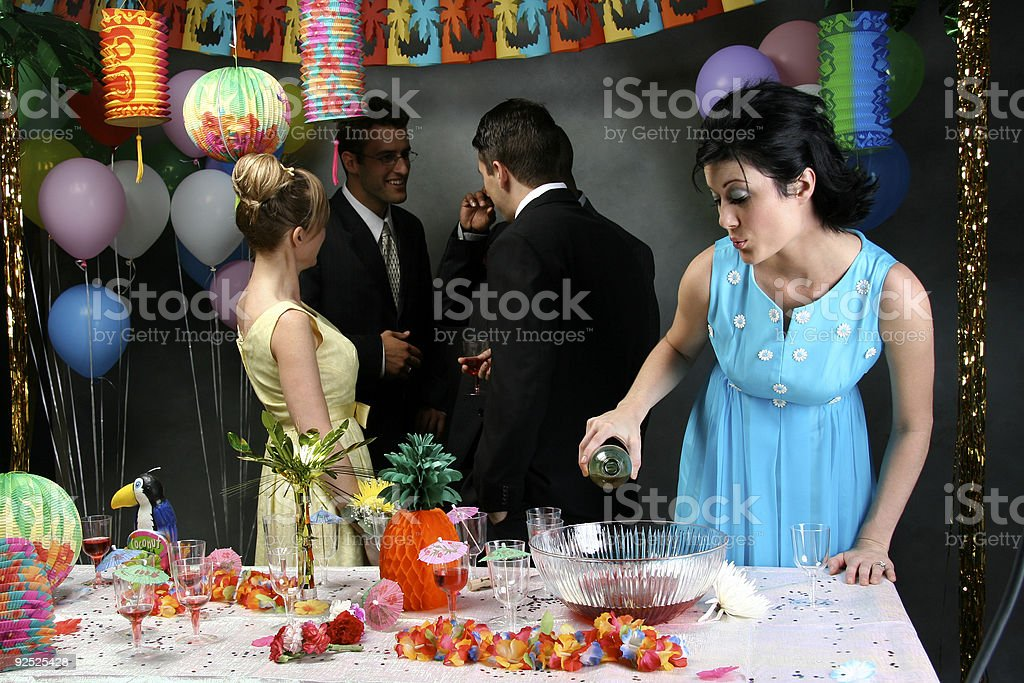 Woman Spiking the Punch royalty-free stock photo