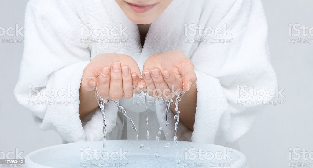 Woman splashing her face with water stock photo