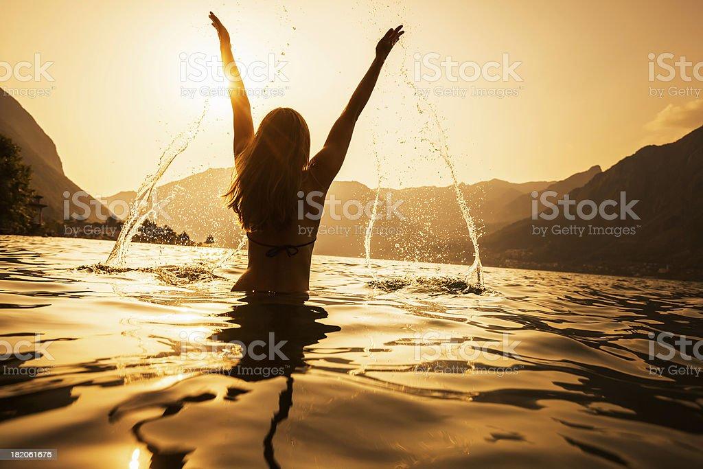 Woman Splashing Water stock photo