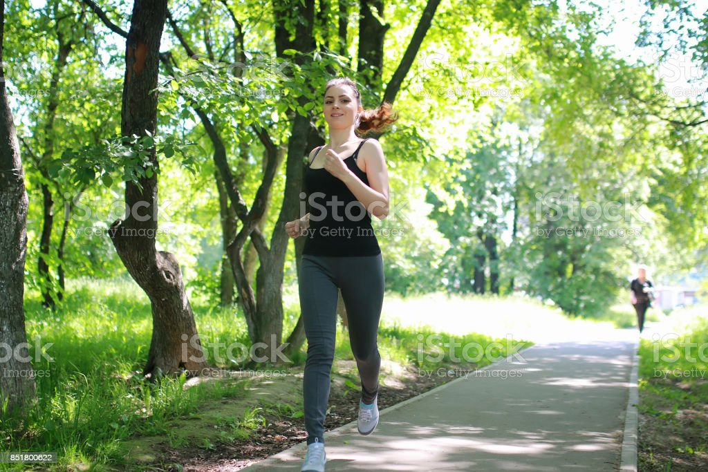 woman sport run in park outdoor stock photo