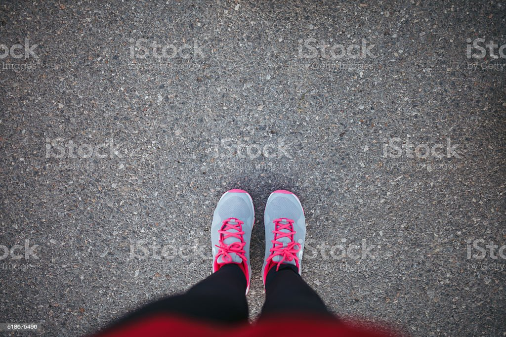 Woman sport shoe on asphalt stock photo