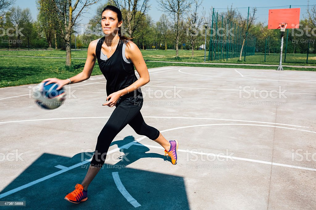 Woman sports training in basketball court stock photo