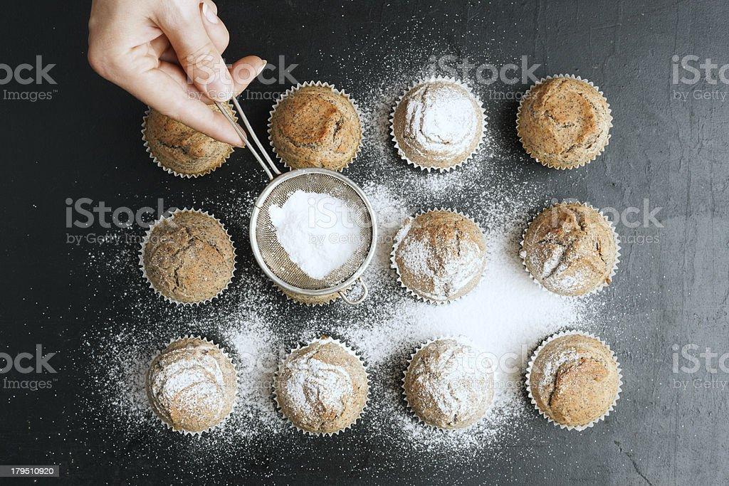 Woman Sprinkling Icing Sugar on Pancakes royalty-free stock photo