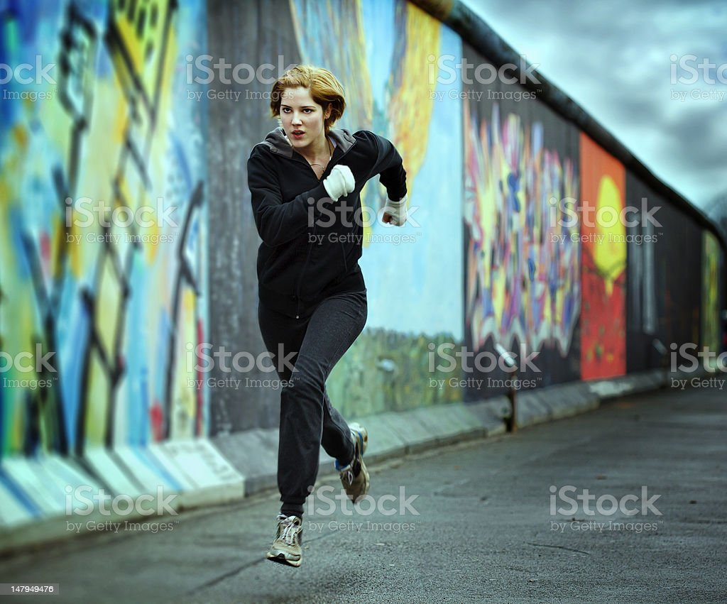 Woman Sprinting the last 100 meters stock photo