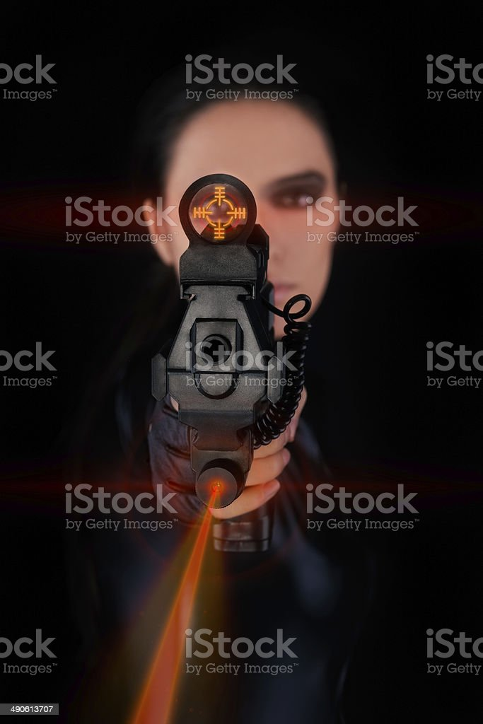 Woman Spy Aiming Gun with Laser Sights stock photo