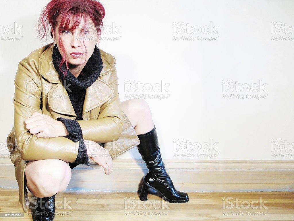 Woman squatting down royalty-free stock photo