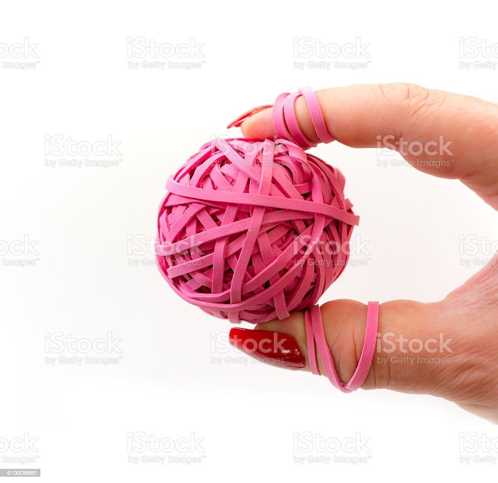 Woman squeezing a tension release ball between tied fingers stock photo