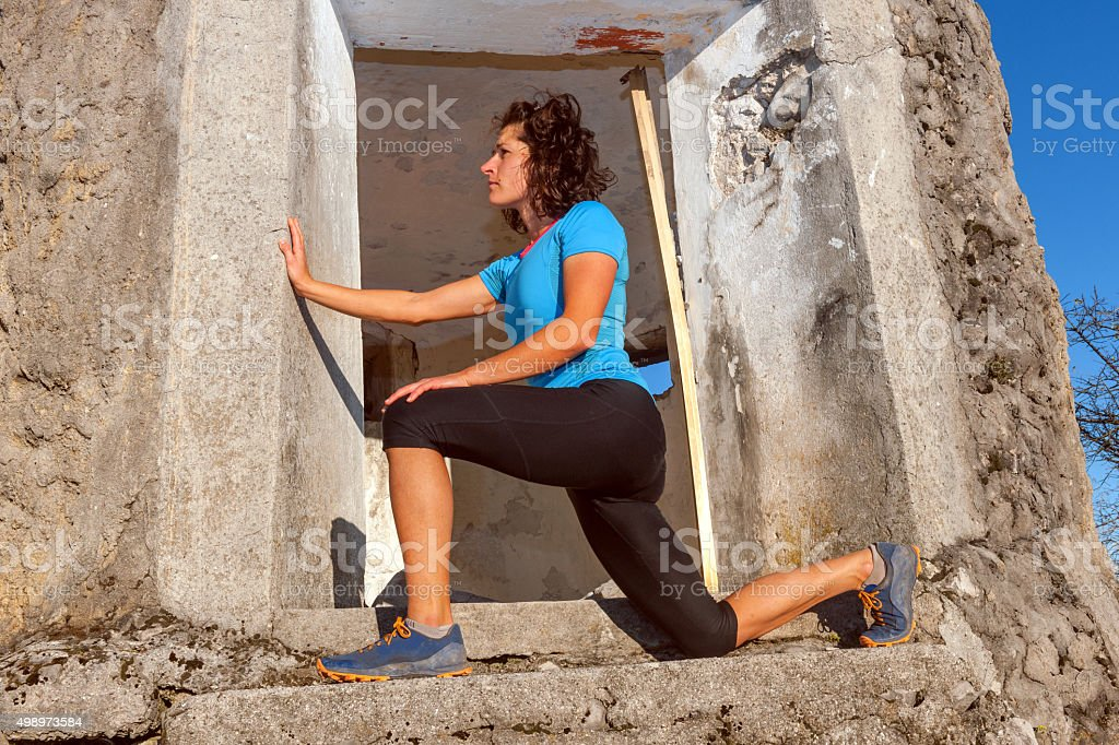 Woman srtetching before a running training,,Primorska Slovenia, stock photo