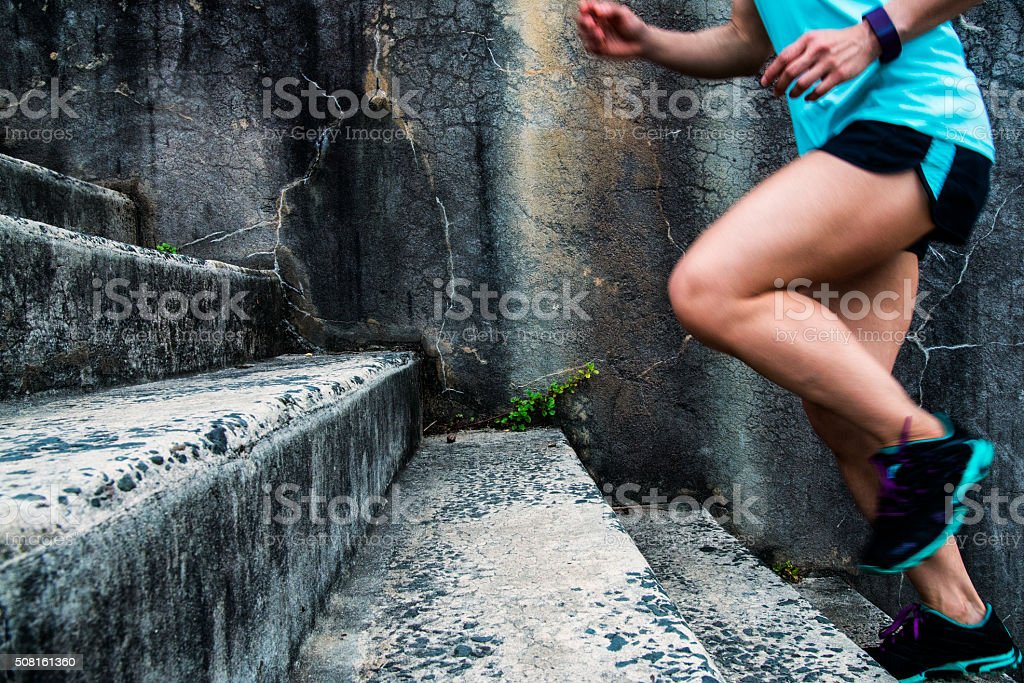 Woman stair climbing for exercise. stock photo