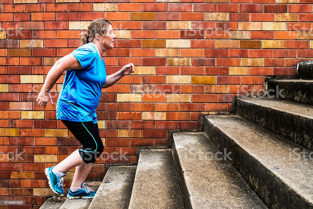 Woman Stair Climbing stock photo