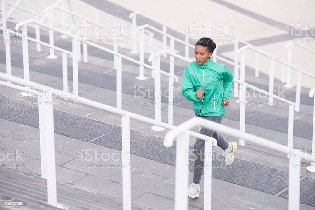 Woman stairs exercising. stock photo