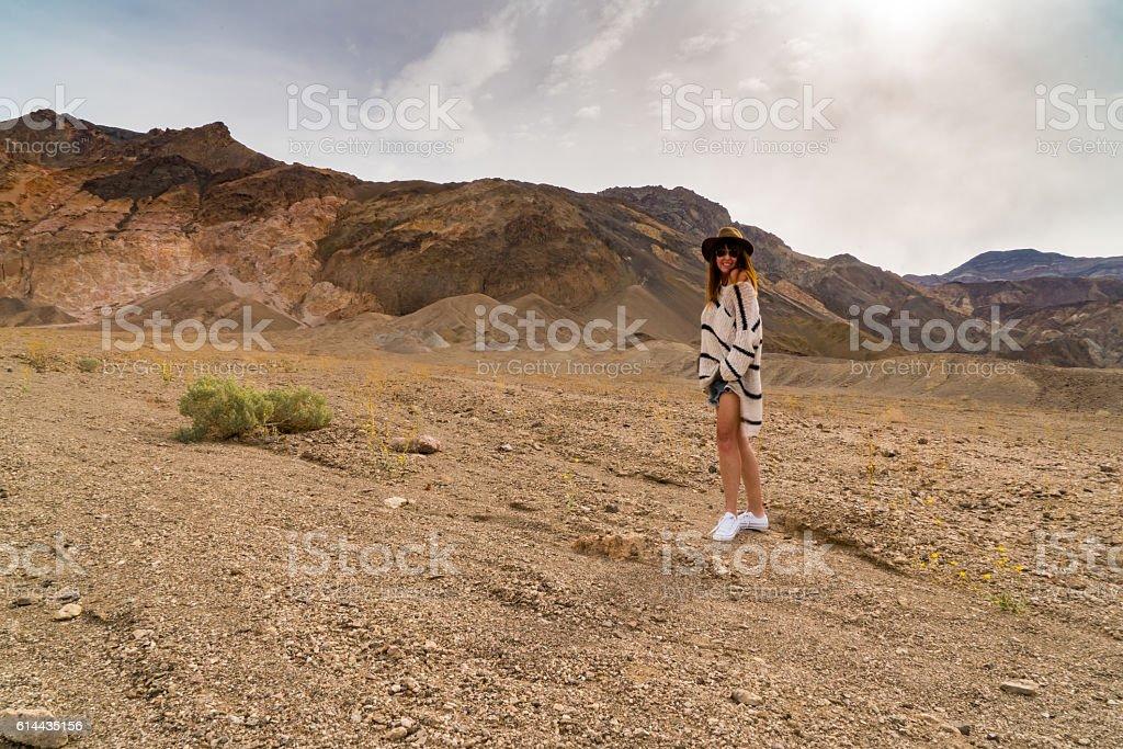 Woman Stand Among Rainbow Colored Canyon stock photo