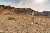 Woman Stand Among Rainbow Colored Canyon