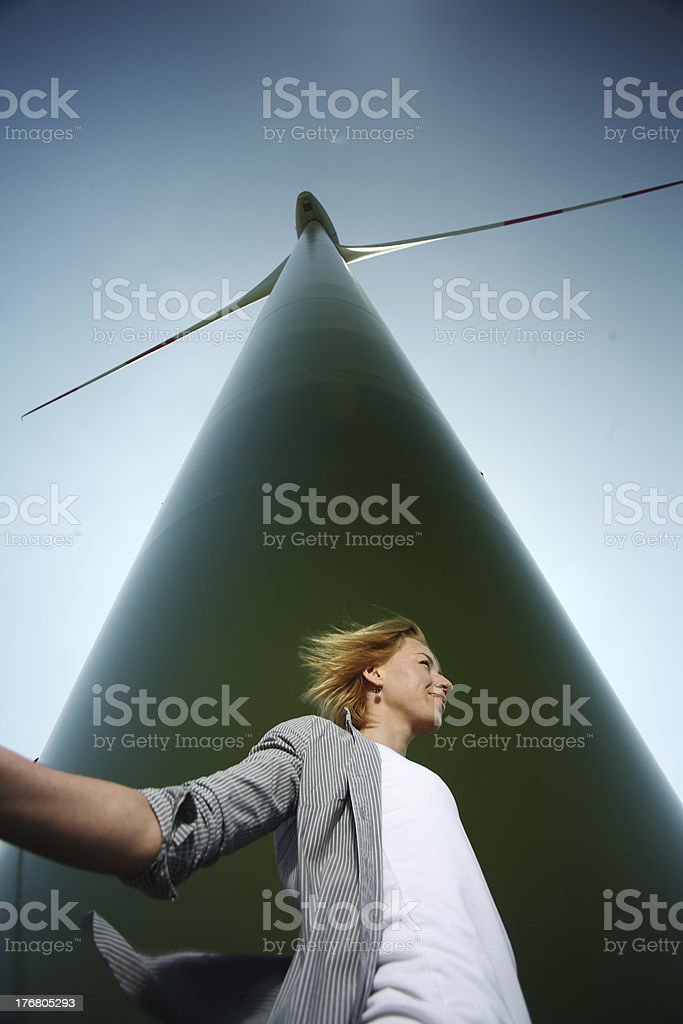 Woman stand at Wind Turbine royalty-free stock photo