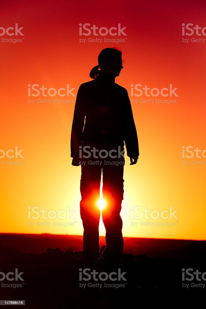 Woman Standing as Silhouette royalty-free stock photo