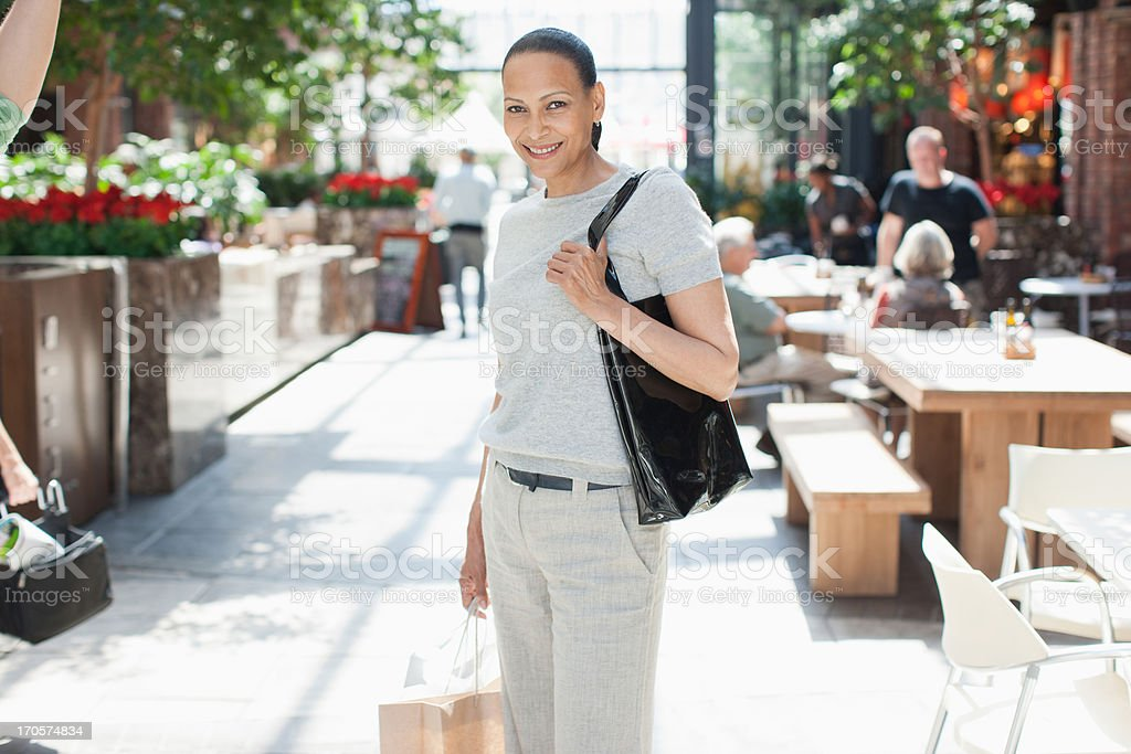 Woman standing at cafe royalty-free stock photo