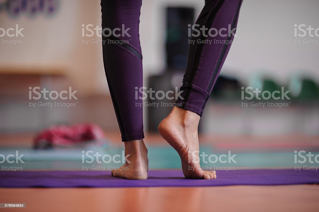 woman standing at yoga class stock photo