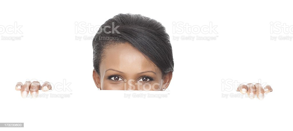 Woman standing behind blank white billboard royalty-free stock photo