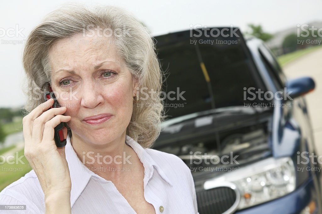 Woman Standing By Her Broken Down Vehicle royalty-free stock photo