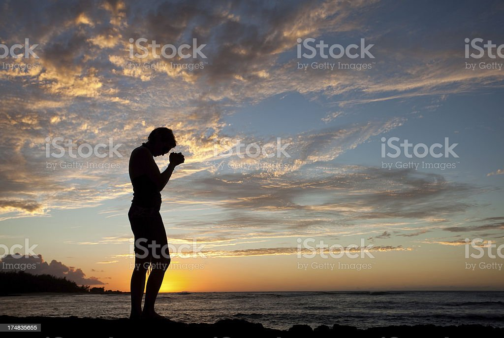Woman Standing by the Sea Praying royalty-free stock photo