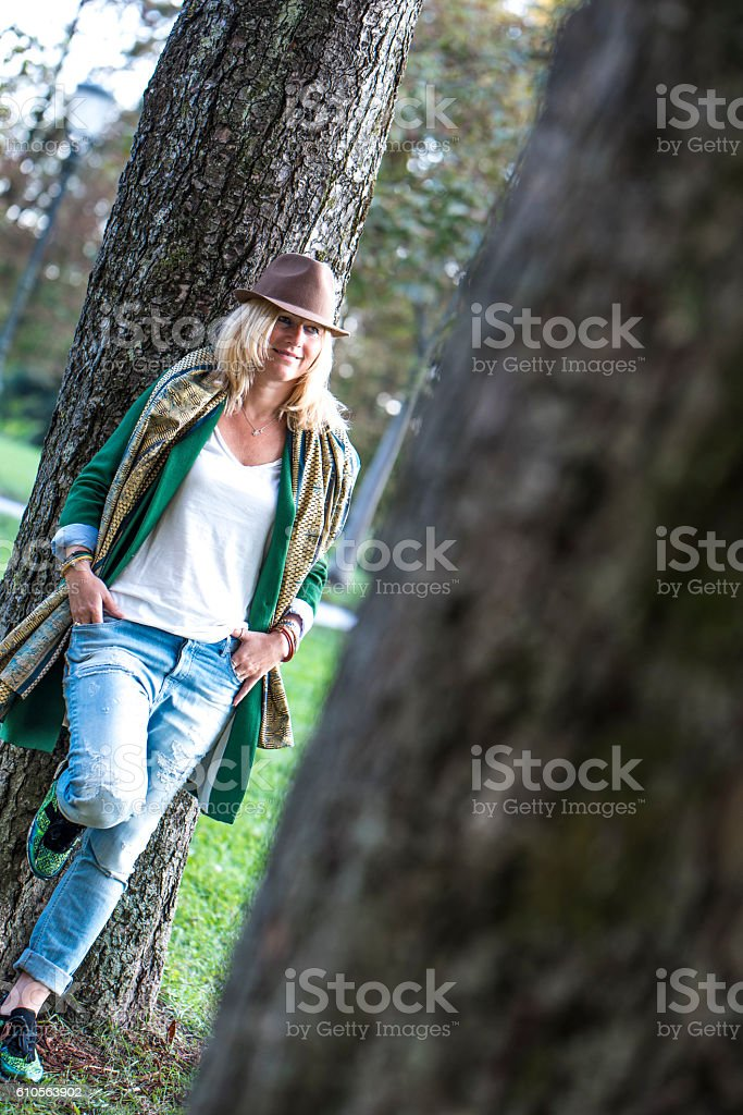 Woman standing by the tree stock photo
