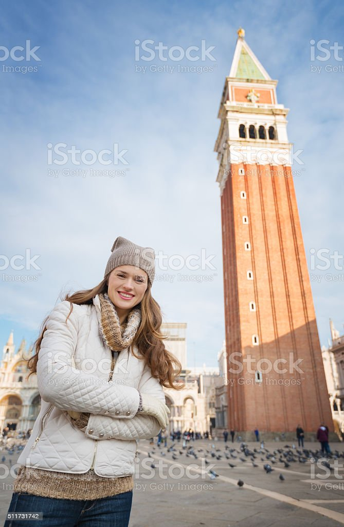 Woman standing in front of Campanile di San Marco stock photo