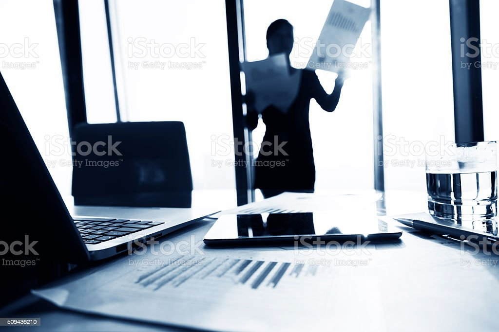 Woman standing in front of window stock photo