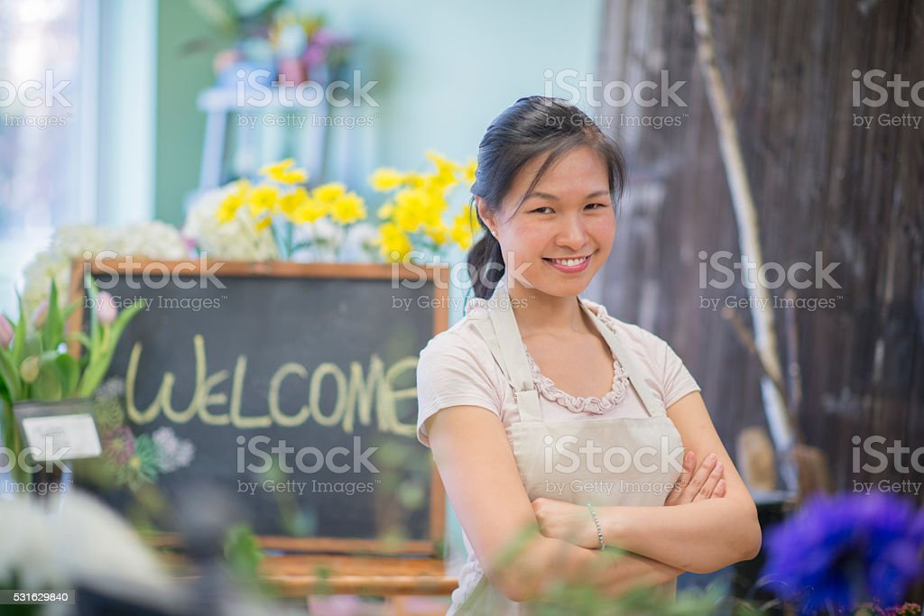 Woman Standing in Her Flower Shop stock photo