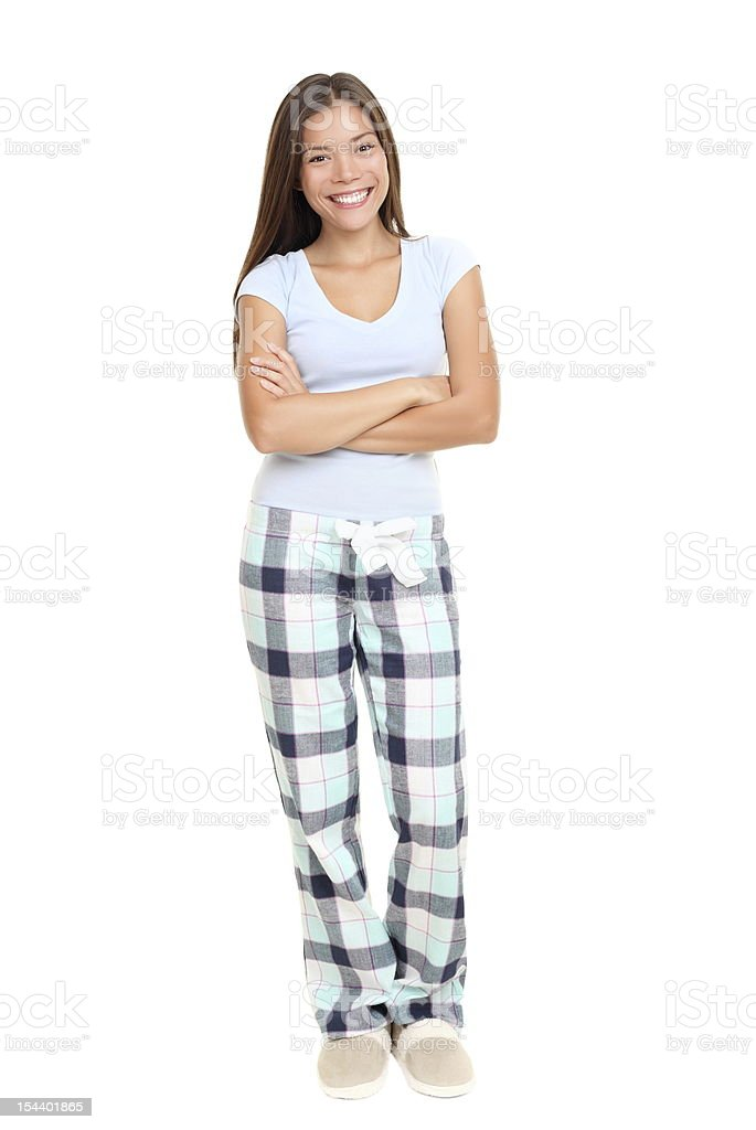 Woman standing in pajamas stock photo