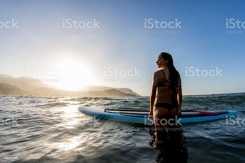 Woman Standing in the Ocean stock photo