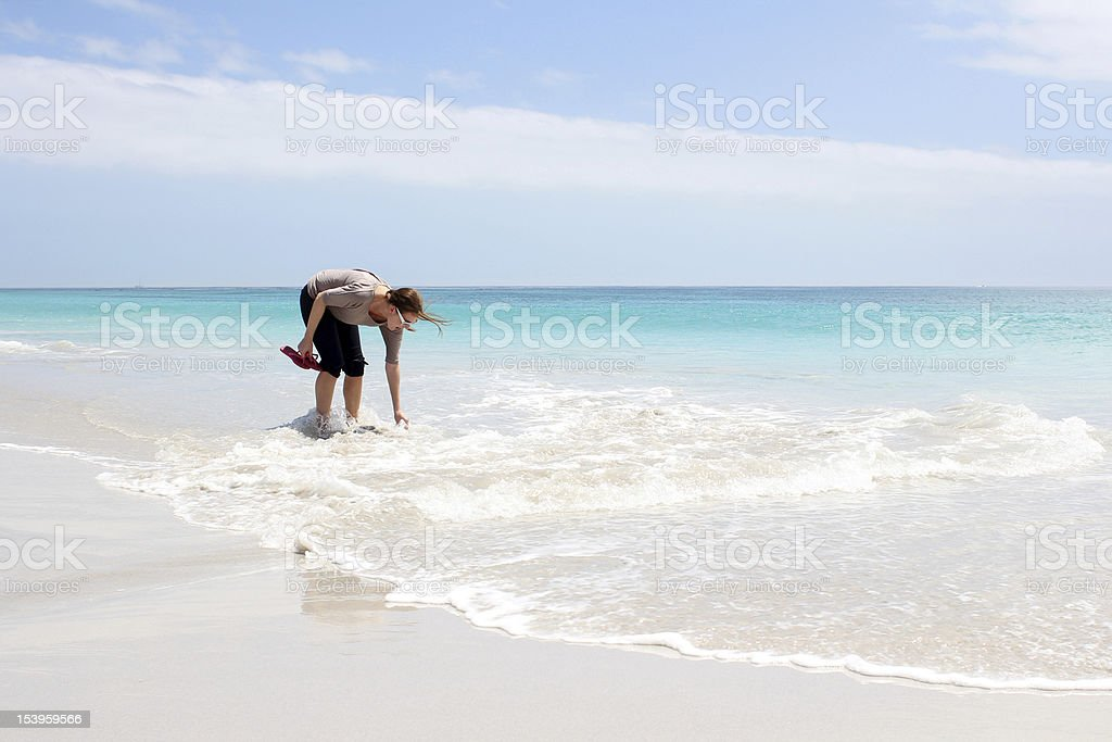 Woman standing in Water stock photo