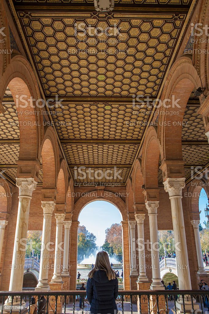 Woman standing inside the porch of Seville Plaza de Espana stock photo