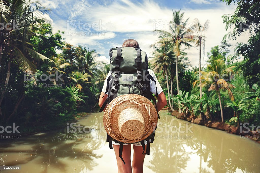 Woman standing near big tropical river stock photo